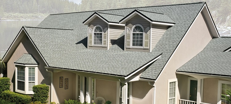 Asphalt roofing on tan house