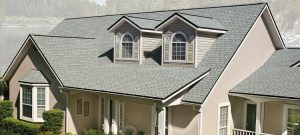 Asphalt roofing on tan house
